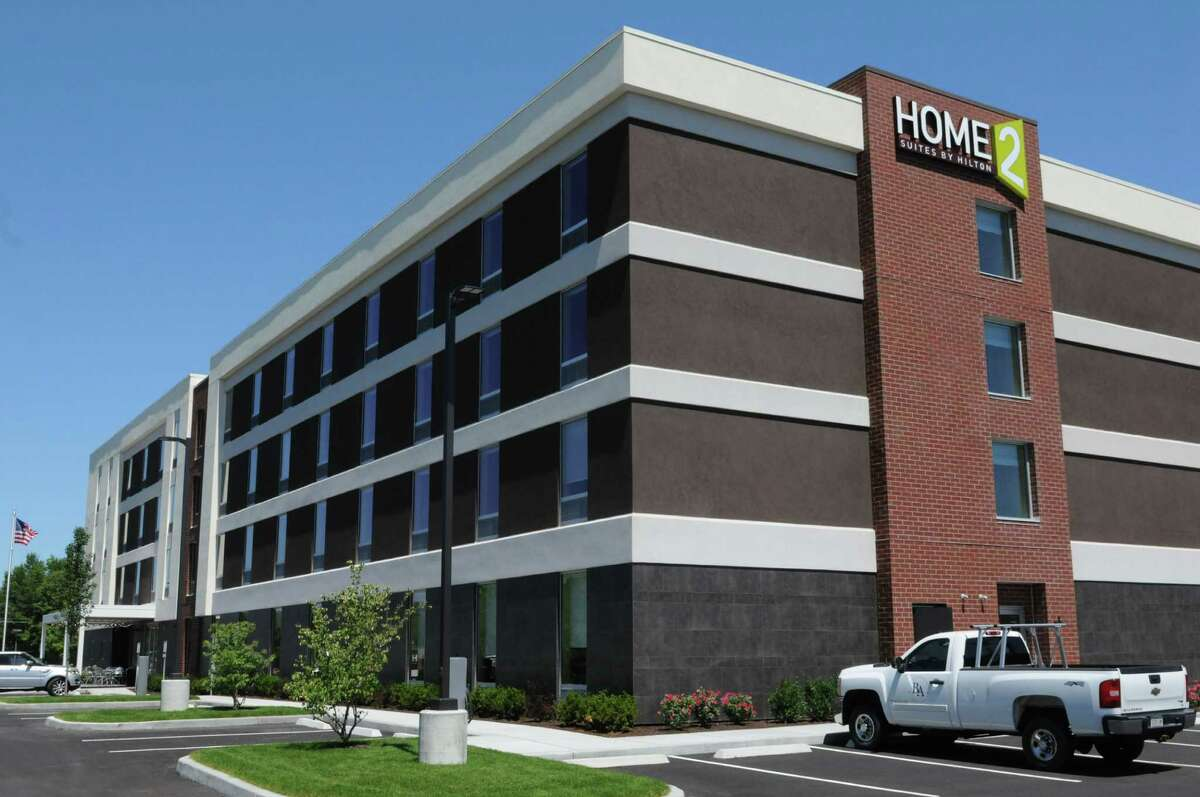 Exterior of the new Home2 Suites by Hilton hotel Monday, July 20, 2015, in Colonie, N.Y. Three suspects were charged in June 2021 with breaking into a woman's room while she was sleeping to steal her purse. (Will Waldron/Times Union) ORG XMIT: MER2015072013103554