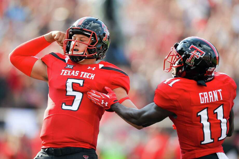 Patrick Mahomes (left0 of the Texas Tech Red Raiders celebrates with Jakeem Grant after scoring a touchdown against the TCU Horned Frogs on Sept. 26, 2015 at Jones AT&T Stadium in Lubbock, Texas. TCU won the game 55-52. Photo: John Weast /Getty Images / 2015 Getty Images