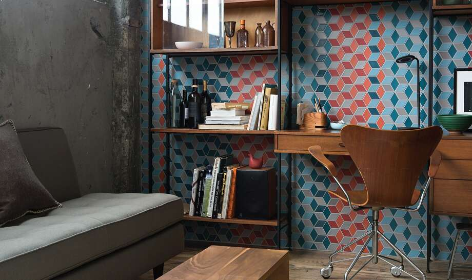 "Pairing strong colors — in tile and accompanying furnishings — pays off, but they must work together, as in this tile installation in Heath's S.F. office. From ""Tile Makes the Room: Good Design From Heath Ceramics,"" ($40; Ten Speed) by Heath co-owners Catherine Bailey and Robin Petravic. Photo: Markio Reed"