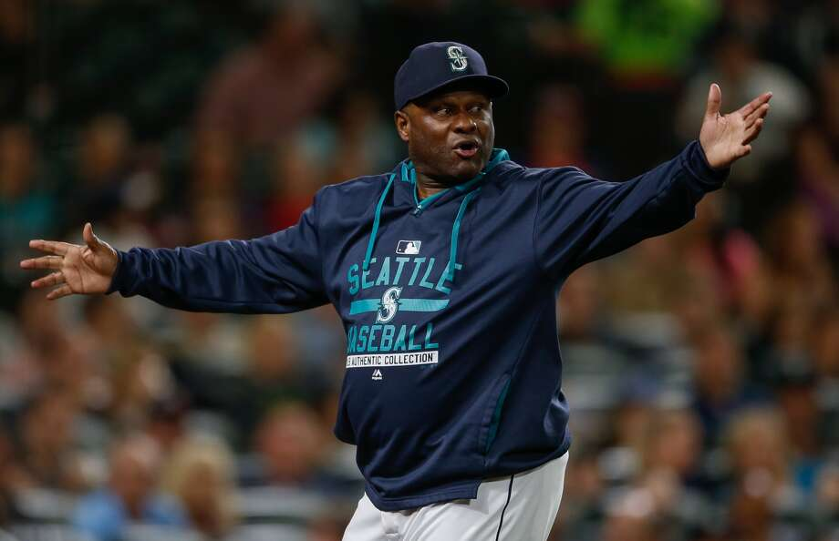 Manager Lloyd McClendon #21 of the Seattle Mariners gestures as he asks for a replay review after Robinson Chirinos of the Texas Rangers was hit by a pitch in the fifth inning at Safeco Field on September 9, 2015 in Seattle, Washington. (Otto Greule, Getty Images)