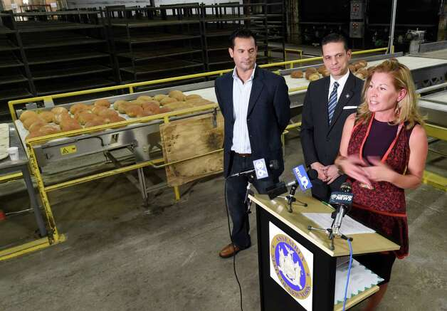 Adine Viscusi, right, speaks at Mastrioanni Brothers Bakery during a press conference announcing the Taste of Schenectady during Manufacturing Week Monday, Sept. 28, 2015, in Schenectady, N.Y. Joining her at the podium are Bobby Mallozzi, left, and Assemblyman Angelo Santabarbara, center.  (Skip Dickstein/Times Union) Photo: SKIP DICKSTEIN / 00033523A