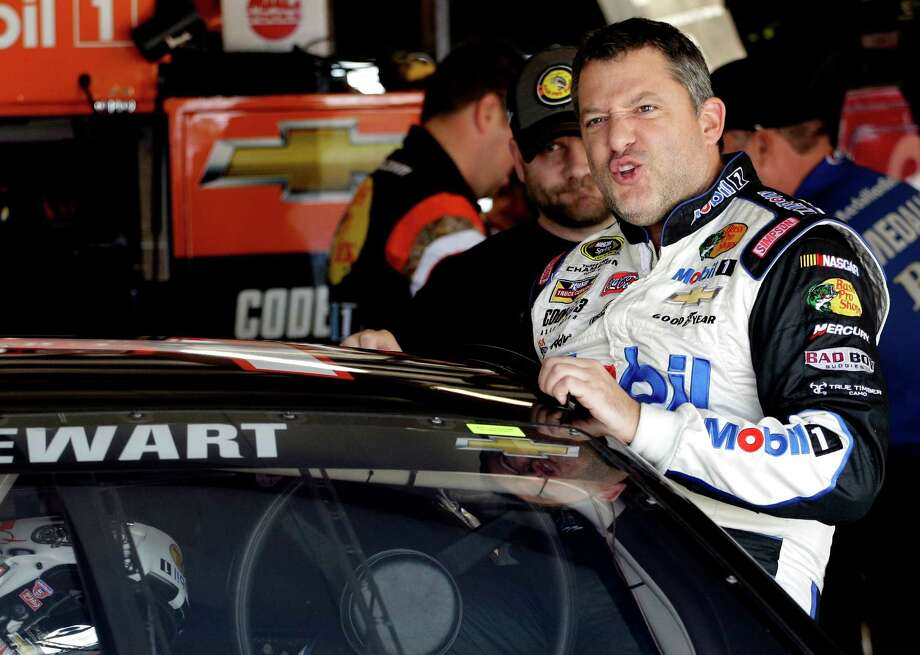 Tony Stewart climbs into his car during practice for the NASCAR Sprint Cup Series auto race at Chicagoland Speedway, Saturday, Sept. 19, 2015, in Joliet, Ill. (AP Photo/Nam Y. Huh) ORG XMIT: ILNH105 Photo: Nam Y. Huh / AP