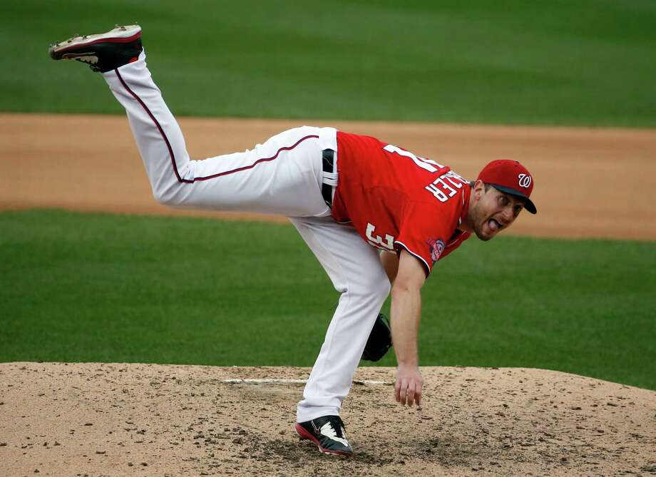 Washington Nationals starting pitcher Max follows through on his throw during the seventh inning of a baseball game against the Cincinnati Reds at Nationals Park, Monday, Sept. 28, 2015, in Washington. The Nationals won 5-1. (AP Photo/Alex Brandon) ORG XMIT: NAT114 Photo: Alex Brandon / AP