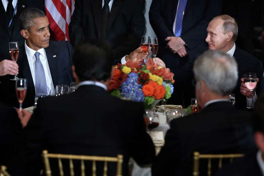 President Barack Obama and Russian President Valdimir Putin toast at a leaders luncheon during the 70th annual United Nations General Assembly at the U.N. headquarters in New York City. Photo: Chip Somodevilla /Getty Images / 2015 Getty Images