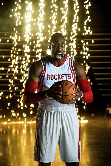 Sparks were flying when Rockets center Dwight Howard made an appearance at the team's annual media gathering at Toyota Center on Monday. Photo: Brett Coomer, Staff / © 2015 Houston Chronicle