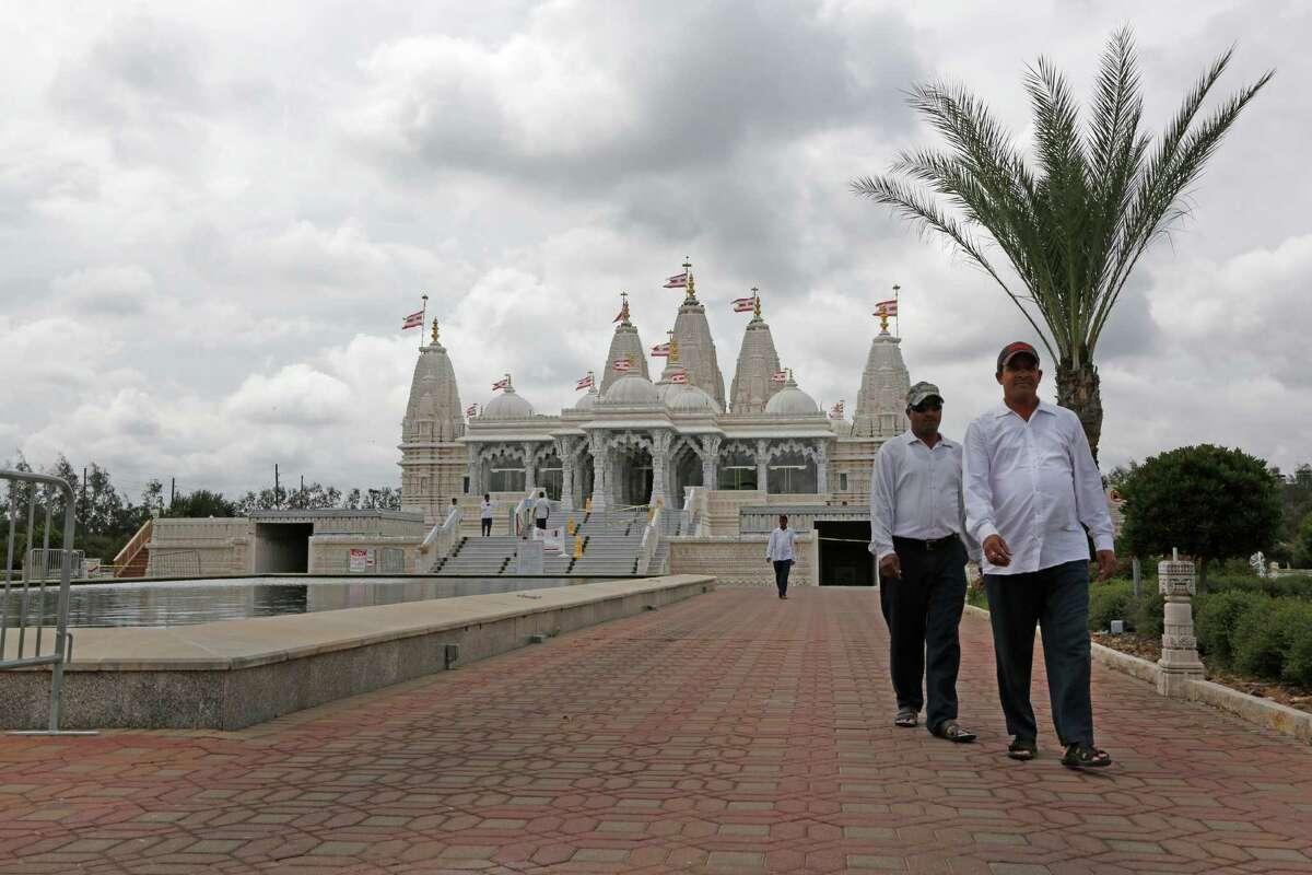 Devotees walk from the BAPS Shri Swaminarayan Mandir Monday, Sept. 28, 2015, in Stafford.
