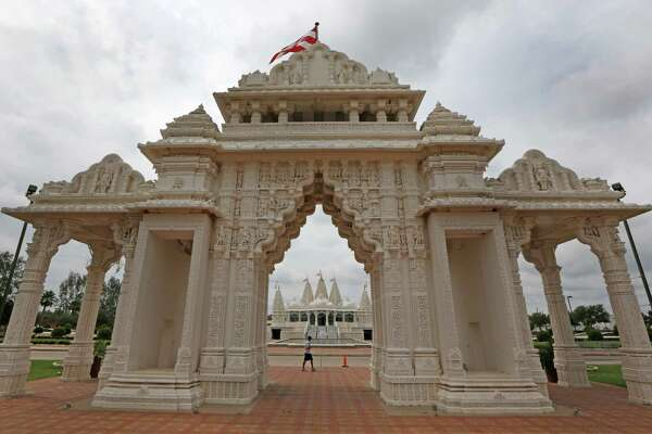 Devotees walk past the BAPS Shri Swaminarayan Mandir Monday, Sept. 28, 2015, in Stafford, Tx. A new Pew study released claims that Asians are on pace to become the largest immigrant group in the the United States. We will focus on Fort Bend Co. where the Asian population is already as big as the Hispanic.