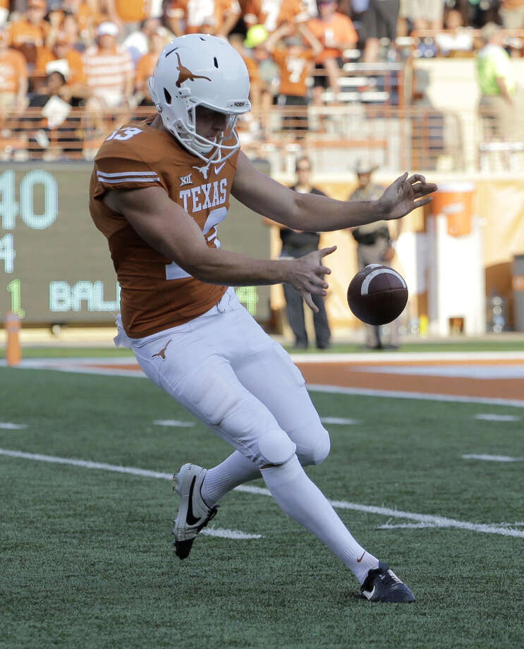 A bobbled snap by Texas punter Michael Dickson late in the fourth quarter cost the Longhorns a chance at overtime Saturday in a 30-27 loss against Oklahoma State. Photo: Eric Gay, Photo By Eric Gay | AP / AP