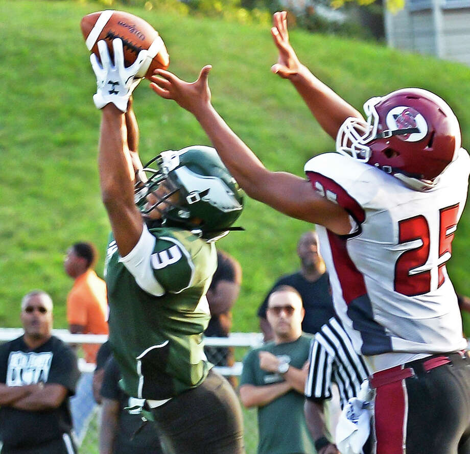 Green Tech's #3 Raki Johnson, left, intercepts a pass meant for Scotia's #25 Ire Pinney during Saturday's game at Bleecker Stadium Sept. 19, 2015 in Albany, NY.  (John Carl D'Annibale / Times Union) Photo: John Carl D'Annibale / 00033441A
