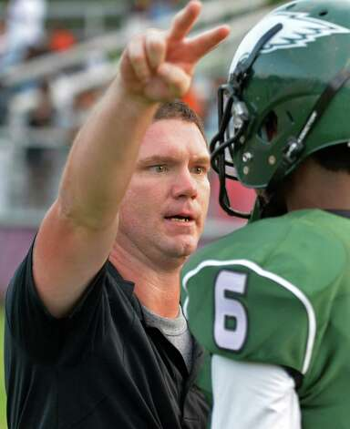 Green Tech head coach Travis Wood, left, with player #6 Messiah Murphy during Saturday's game against Scotia at Bleecker Stadium Sept. 19, 2015 in Albany, NY.  (John Carl D'Annibale / Times Union) Photo: John Carl D'Annibale / 00033441A