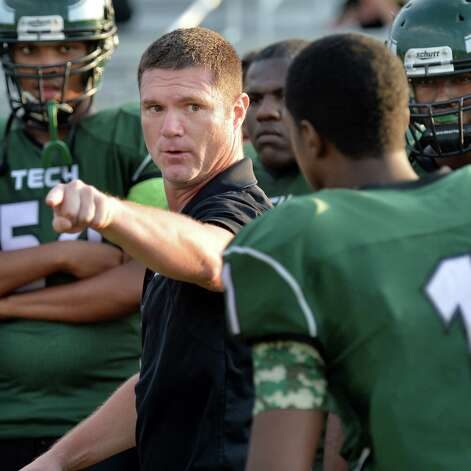 Green Tech head coach Travis Wood, center, with players on the side lines during Saturday's game against Scotia at Bleecker Stadium Sept. 19, 2015 in Albany, NY.  (John Carl D'Annibale / Times Union) Photo: John Carl D'Annibale / 00033441A