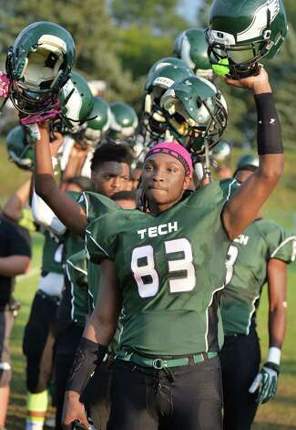 Green Tech's #83 T.J. Roberts and team mates raise their helmets before the start of Saturday's game against Scotia at Bleecker Stadium Sept. 19, 2015 in Albany, NY.  (John Carl D'Annibale / Times Union) Photo: John Carl D'Annibale / 00033441A