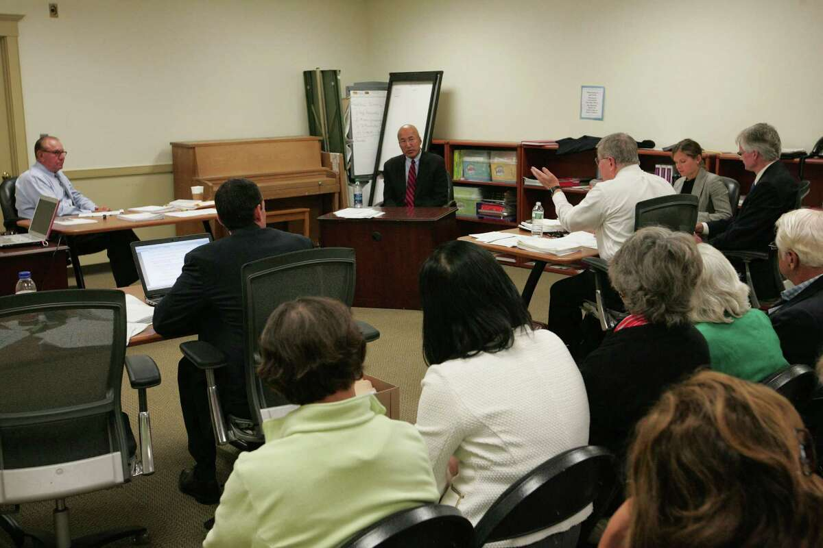 Greenwich High School band director John Yoon continues his testimony in his appeals hearing for wrongful termination. The proceedings, attended by several of his supporters, took place at the Greenwich Board of Education offices on Monday.