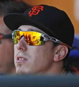San Francisco Giants' Tim Lincecum sits in the dugout during the eighth inning of a baseball game against the St. Louis Cardinals, Sunday, Aug. 30, 2015, in San Francisco. (AP Photo/George Nikitin)