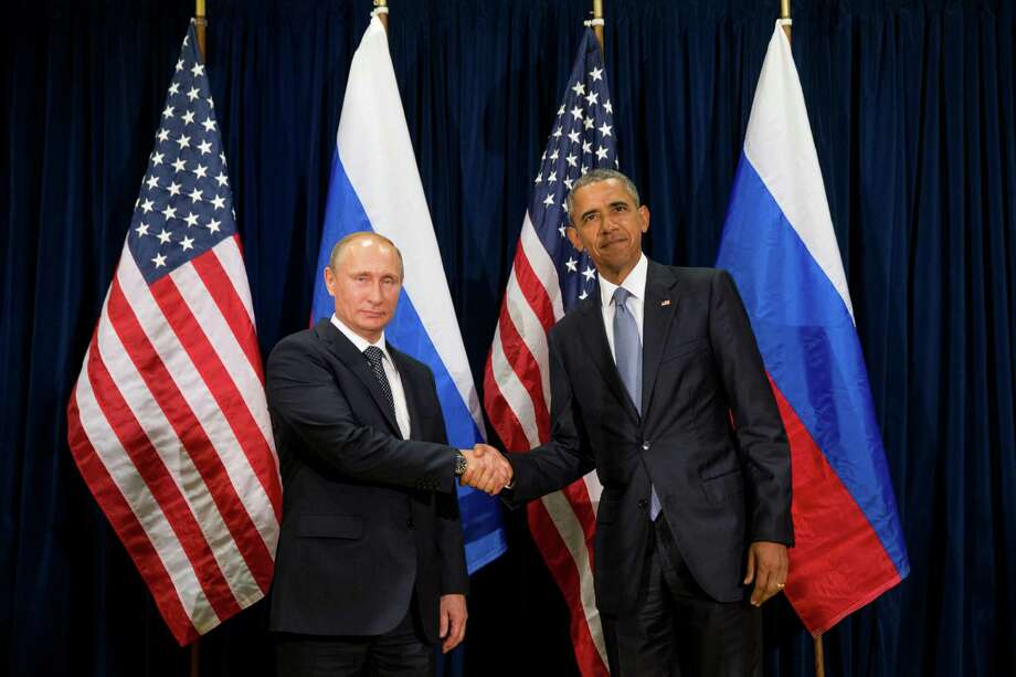 United States President Barack Obama, right, and Russia's President President Vladimir Putin pose for members of the media before a bilateral meeting Monday, Sept. 28, 2015, at United Nations headquarters. (AP Photo/Andrew Harnik) ORG XMIT: XUNH300 Photo: Andrew Harnik / AP