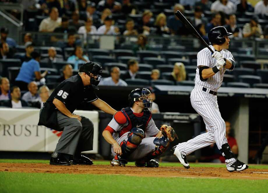 NEW YORK, NY - SEPTEMBER 28:  Jacoby Ellsbury #22 of the New York Yankees doubles against the Boston Red Sox in the first inning during their game at Yankee Stadium on September 28, 2015 in New York City.  (Photo by Al Bello/Getty Images) ORG XMIT: 538595797 Photo: Al Bello / 2015 Getty Images