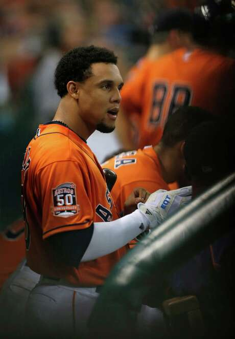 Houston Astros center fielder Carlos Gomez (30) in the dugout in the second inning of an MLB game at Minute Maid Park on Friday, July 31, 2015, in Houston. ( Karen Warren / Houston Chronicle ) Photo: Karen Warren, Staff / © 2015 Houston Chronicle