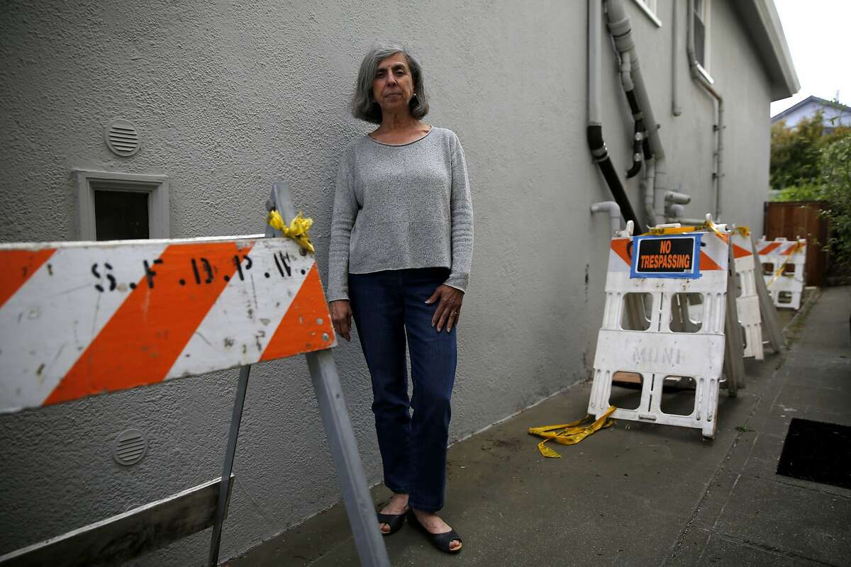 Libby Noronha stands on the pathway between her house and her neighbor's house in San Francisco, California, on Monday, Sept. 28, 2015.