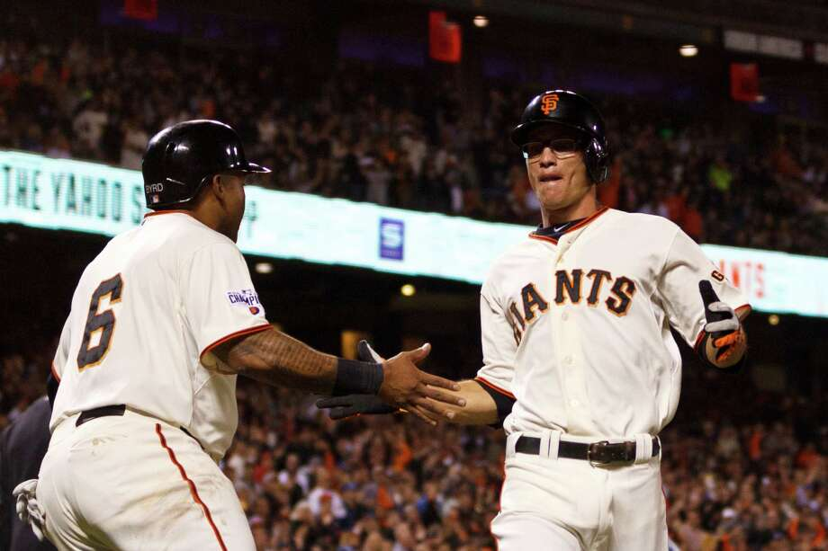 Marlon Byrd #6 of the San Francisco Giants celebrates with Kelby Tomlinson #37 after both scored on a double hit by Trevor Brown (not pictured) during the second inning against the Los Angeles Dodgers at AT&T Park on September 28, 2015 in San Francisco. Photo: Jason O. Watson / Getty Images / 2015 Getty Images