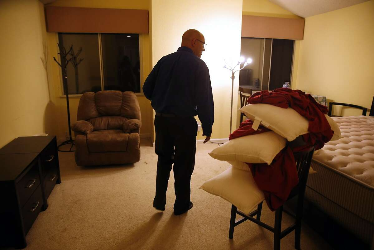 Former homeless Apple bus driver Scott Peebles walks into his newly rented room in a townhouse for the first time in Fremont, Calif., on Monday, September 28, 2015.