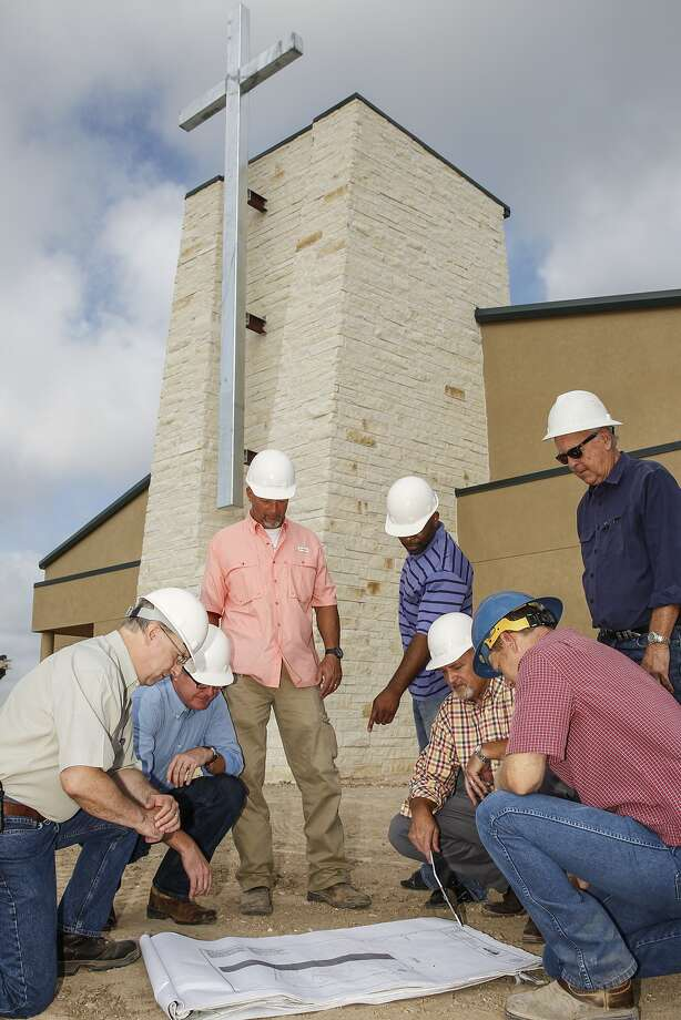 Construction managers and church elders go over blue prints on July 24, 2015 of the new Greenhouse Community Church in Katy. Pictured are Elder Bob Hill, Pastor Stan Newton, Steve Lindley, Chris Lynce, Project Manager Jay Lindley, Architect Joe Milton, and Superintendent Layne Wilson. Photo: Diana L. Porter, Freelance / © Diana L. Porter