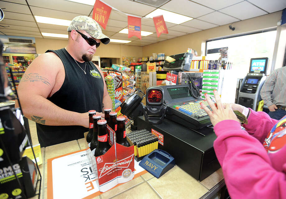 Lumberton convenience stores are now selling alcohol and the city's restaurants are soon to be doing the same. On Wednesday, Matthew Leyendecker was the first person to purchase beer at Crawdad's since the establishment received its license. Several restaurants are in the application phase to receive a liquor license.  Photo taken Thursday, January 10, 2013 Guiseppe Barranco/The Enterprise Photo: Guiseppe Barranco, STAFF PHOTOGRAPHER / The Beaumont Enterprise