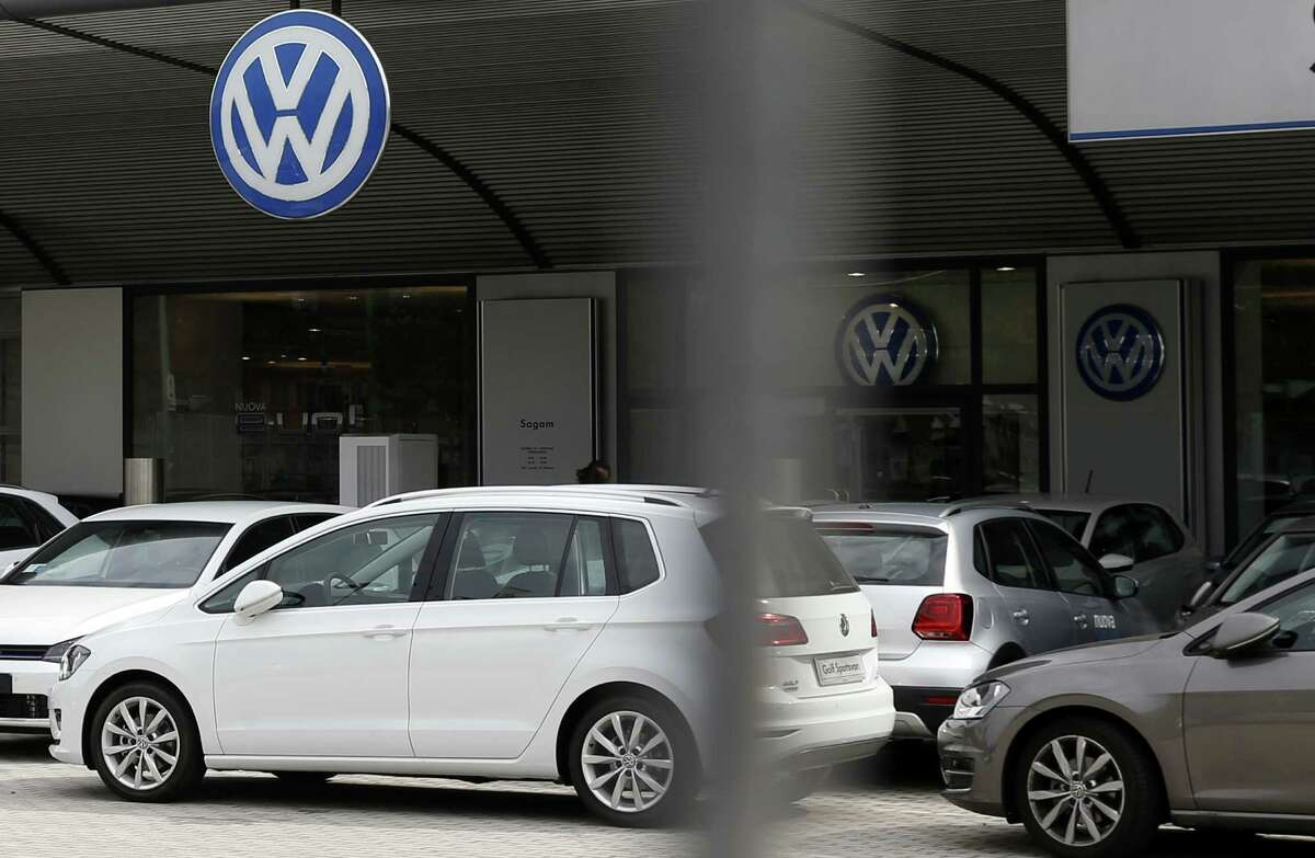 Cars are parked in a Volkswagen dealer in Milan, Italy, Sunday, Sept. 27, 2015. German media report that Volkswagen received warnings years ago about the use of illegal tricks to defeat emissions tests. The automaker admitted last week that it used special software to fool U.S. emissions tests for its diesel vehicles.