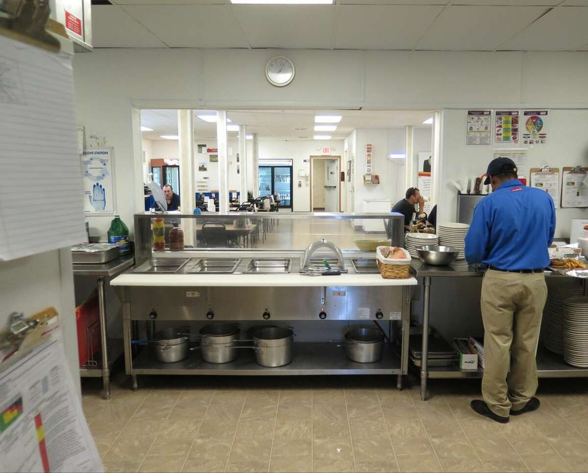 The kitchen and dining hall of a Reliant Asset Management man camp near Williston, North Dakota is seen in this Sept. 23, 2014 photo. While the words