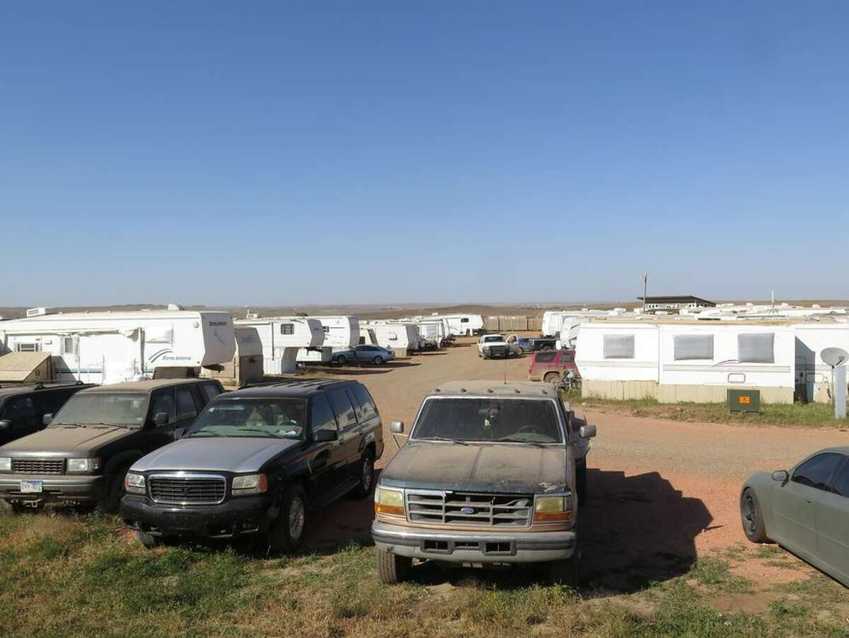 A trailer park near Watford City, N.D., is seen in this Sept. 23, 2014 photo. In North Dakota's oil patch, worker accommodations can be rough: men sleep in tiny trailers with boarded windows, parked cars and overcrowded apartments. Top-end man camps are on the other end of the spectrum, functioning almost like hotels with luxuries that other housing options do not have. (AP Photo/Josh Wood)