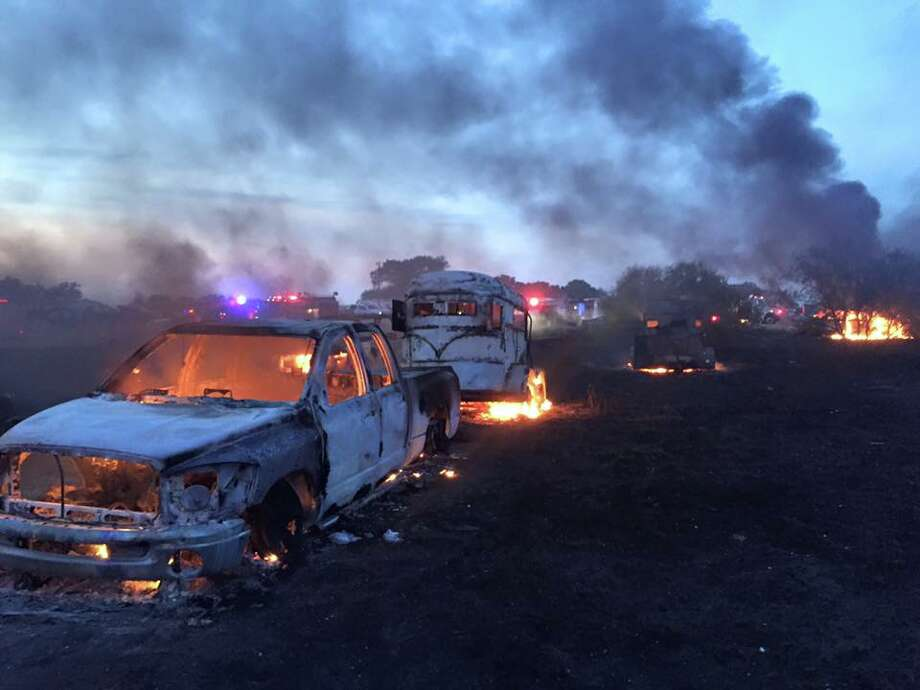 More than two dozen trucks and trailers were destroyed in a giant fire Sunday during a trail ride in Lexington. Photo: Blue Volunteer Fire Department