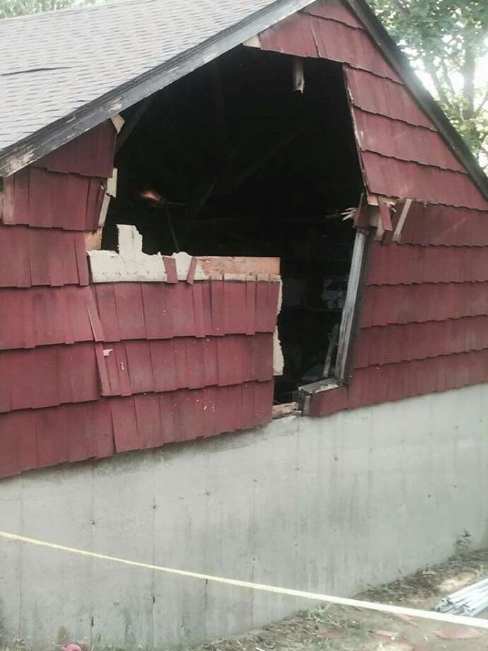 An SUV went through a garage on Nichols Avenue in Stratford on Monday. Photo: Provided Photo / Stratford Firefighters Union Via Facebook