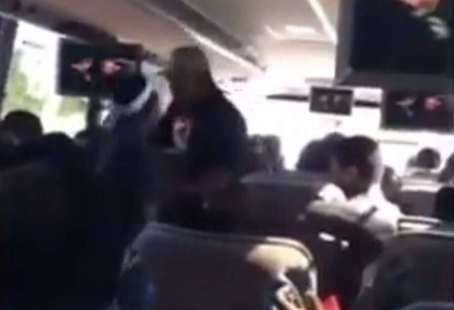 McClymonds High School junior varsity football coach De'Carlos Anderson was placed on administrative leave after video surfaced of him tackling student during a bus trip. Photo: Twitter: @Jacob_Center