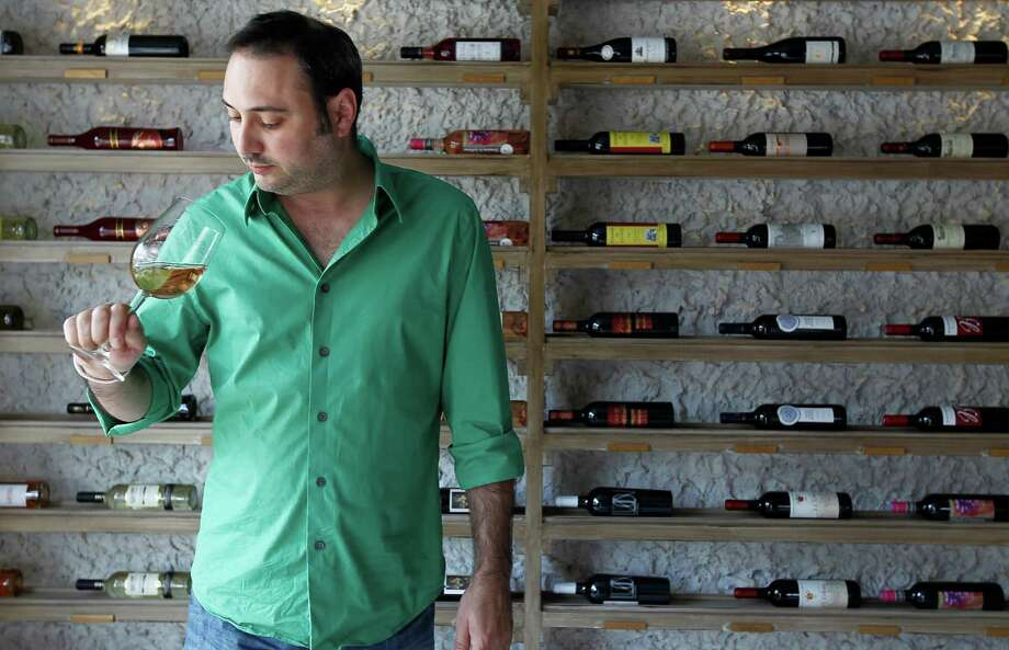 Marc Borel, who will be the new beverage director for the Rainbow Lodge, is shown sampling a glass of wine during his days as general manager in 2011. Photo: Karen Warren, Houston Chronicle / © 2011 Houston Chronicle
