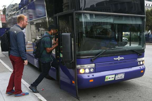 Yahoo employees board a shuttle bus driven by Tracy Kelley at Van Ness Avenue and McAllister Street in San Francisco, Calif. on Tuesday, Sept. 29, 2015.