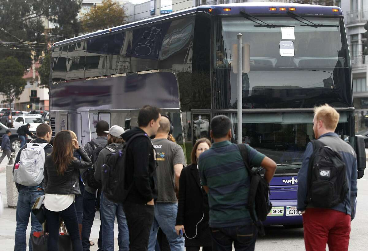 A shuttle bus driven by Tracy Kelley pulls into a stop at Van Ness Avenue and McAllister Street to pick up Yahoo employees in San Francisco, Calif. on Tuesday, Sept. 29, 2015.