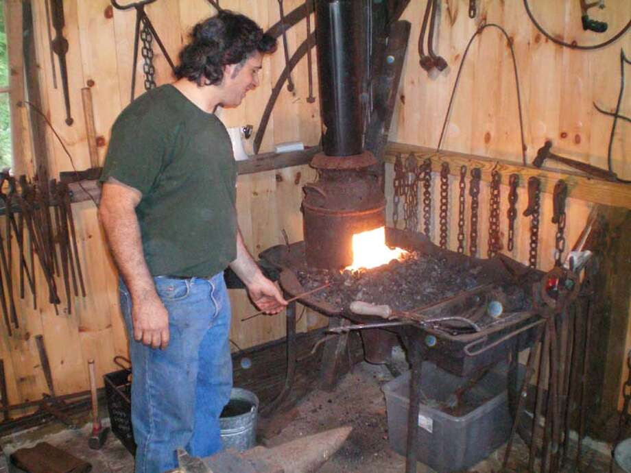 Ron Blessey at Gurski Forge oven. Blessey will give a blacksmith demonstration at Brookfield's Farmfest on Sunday, Oct. 4, 2015. Photo: Brookfield Historical Society