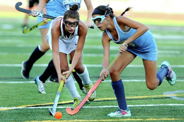 Burnt Hills' Elise Zwicklbauer, left, battles Columbia's Renee Smith for the ball during their field hockey game on Friday, Sept. 25, 2015, at Burnt Hills High in Burnt Hills, N.Y. (Cindy Schultz / Times Union) Photo: Cindy Schultz, Albany Times Union / 10033488A