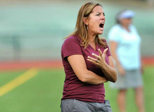 Burnt Hills' coach Kelly Vrooman, center, encourages her team during their field hockey game against Columbia on Friday, Sept. 25, 2015, at Burnt Hills High in Burnt Hills, N.Y. (Cindy Schultz / Times Union) Photo: Cindy Schultz, Albany Times Union / 10033488A