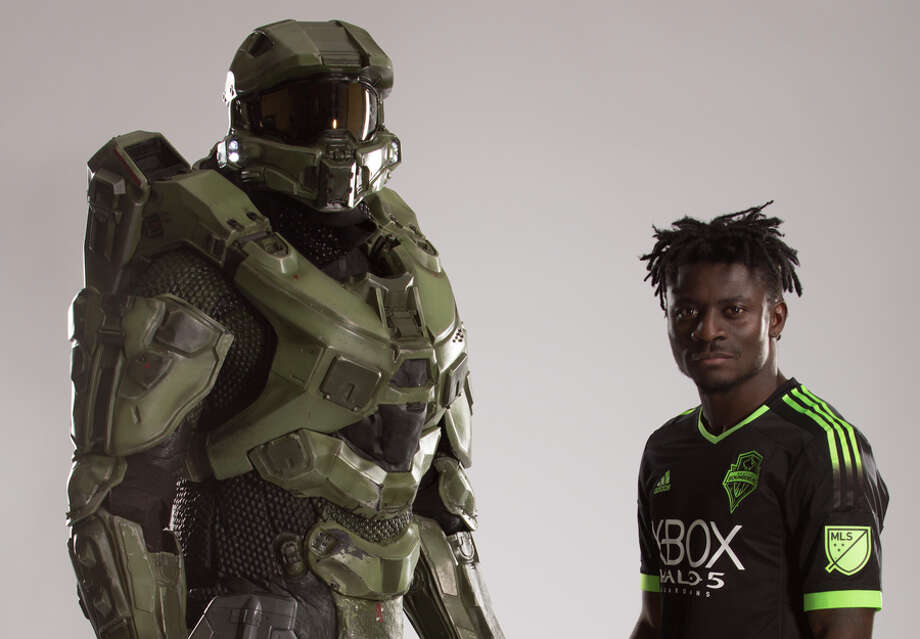 Sounders FC forward Obafemi Martins models the team's new 'Halo'-themed kit alongside game character Master Chief. Photo: Image Courtesy Of Microsoft