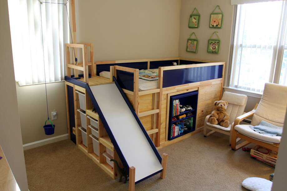 Palo Alto dad Eric Strong spent $850 on Ikea furniture and products to create the ultimate kids bed with a slide and secret room hidden behind a book shelf. Photo: Eric Strong