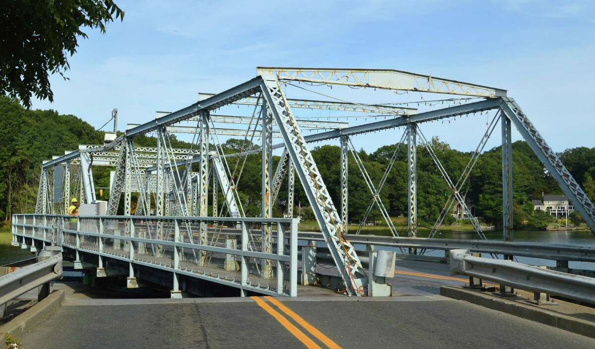 The Bridge Street bridge, formally the William F. Cribari Memorial Bridge, is swung into its open position by a state Department of Transportation workers after being notified that a boater wants to pass through.