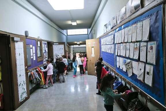 Students fills the hallways as they break for recess at Montclair Elementary School.