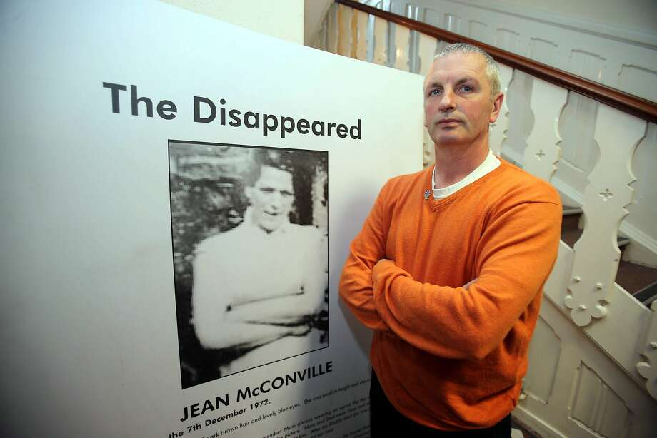 Michael McConville stands by a photo of his mother, Jean, whom the IRA said was an informer. Photo: Associated Press