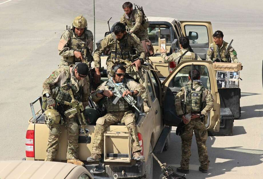Afghan special forces arrive at the Kunduz airport as they launch a counteroffensive to retake the strategic northern city from Taliban insurgents. Photo: Nasir Waqif, AFP / Getty Images