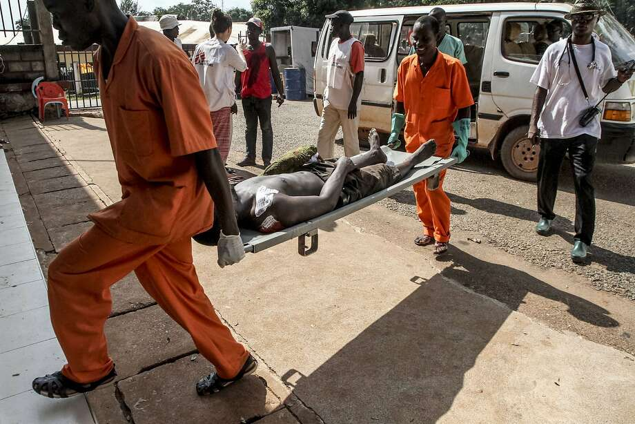 A wounded man is carried into the General Hospital in Bangui after unknown assailants opened fire in the a neighborhood with a majority of Muslim residents. Photo: Edouardo Dropsy, AFP / Getty Images
