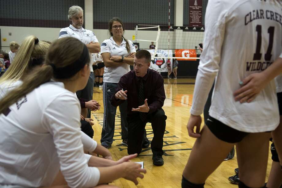 Clear Creek head volleyball coach Scott Simonds, center, works a timeout with his team against Coppell in their championship game at the 2015 Adidas Texas Volleyball Invitational at Pearland High School on Saturday, August 15, 2015. (Photo by Jerry Baker/Freelance) Photo: Jerry Baker, Freelance