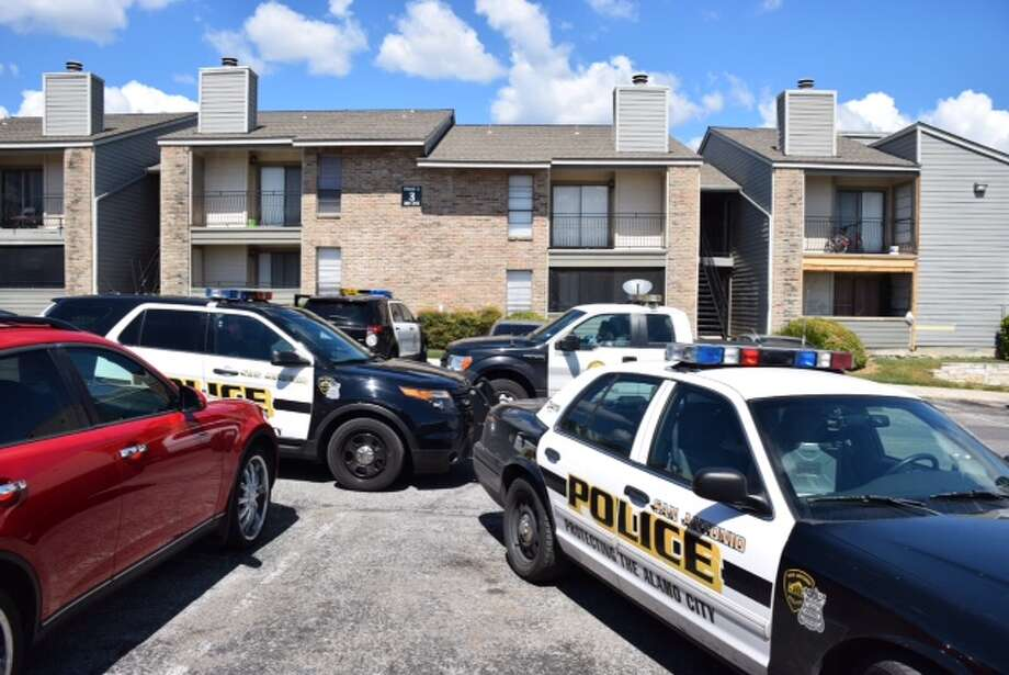 A man died and a woman was critically wounded Tuesday afternoon after a gunman opened fire inside an apartment on the Northside of town. Photo: Mark D. Wilson/ San Antonio Express-News