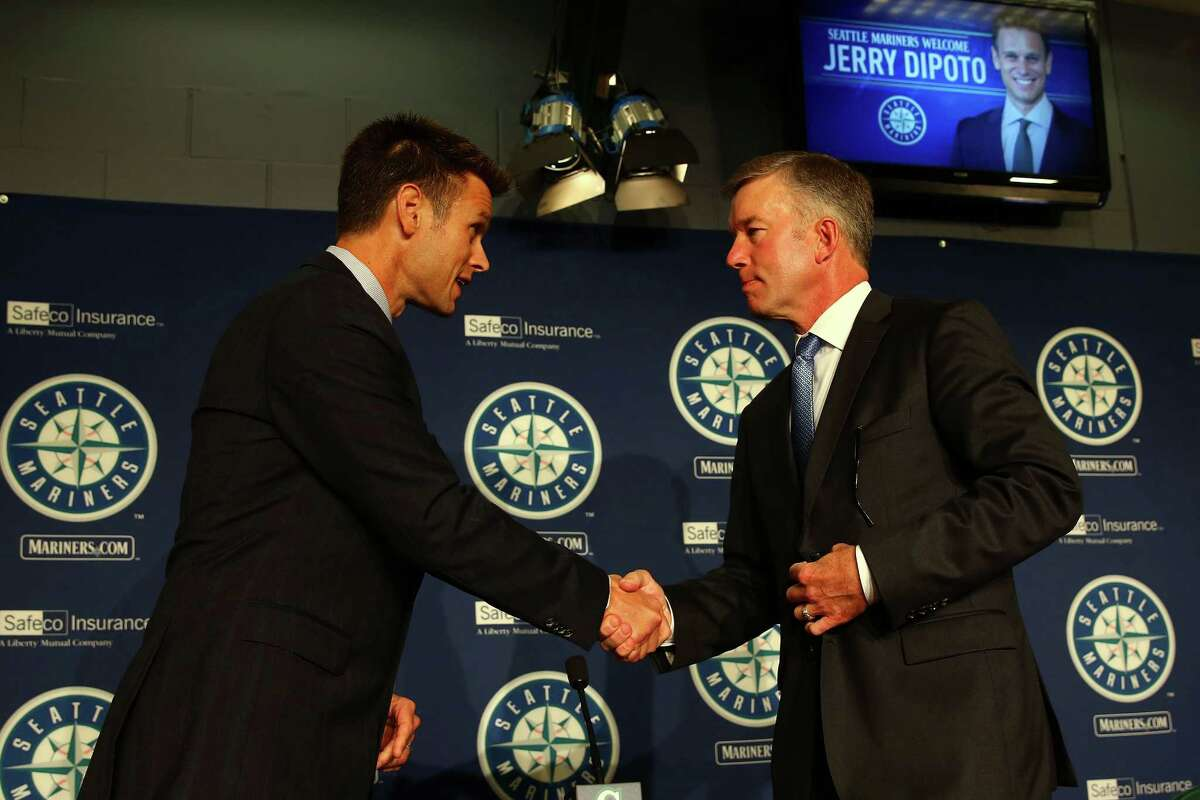 Jerry Dipoto shakes hands with President Kevin Mather after he was introduced as the new Mariners General Manager at Safeco Field. Dipoto resigned his position as GM of the Los Angeles Angels in July of this year. Photographed Tuesday, September 29, 2015.