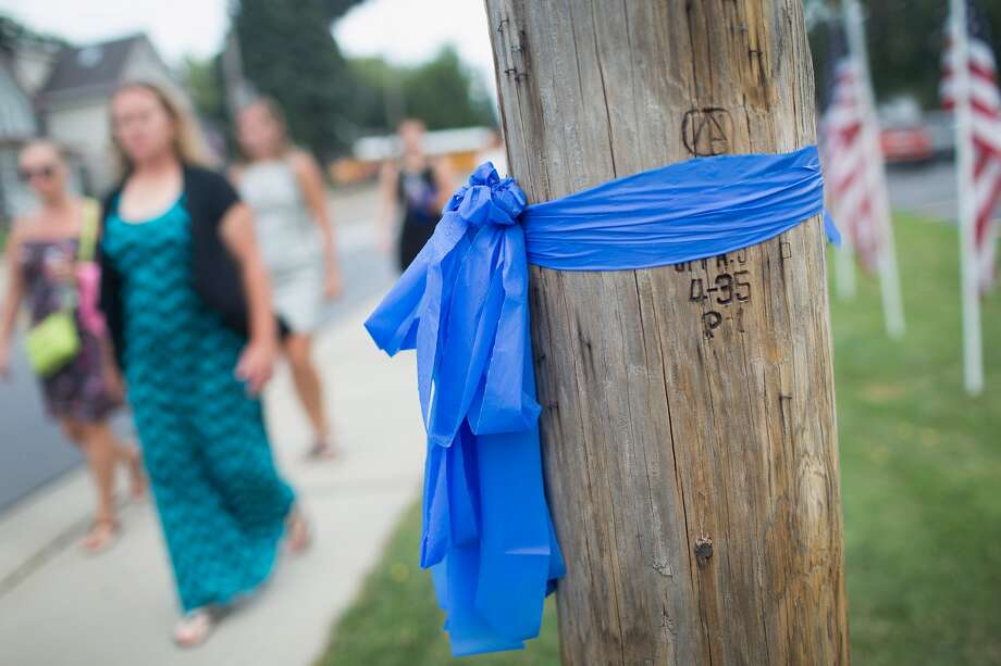 Blue ribbons are a common symbol of support for law enforcement. The ribbon pictured above was hung in commemoration of an Illinois police officer who died in August. In Dallas, residents were surprised to find their ribbons removed from local street signs and trees by officials with the city's code compliance department. Photo: Getty Images