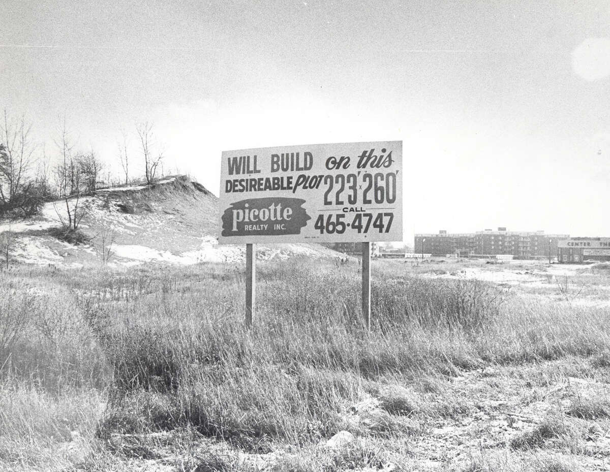 A sign stands on a sand dune at the future home of Borders bookstore. (Handout from Richard J. Naylor, author of